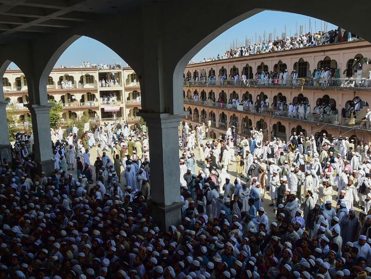Supporters gather for the funeral prayer for Maulana Sami Ul-Haq
