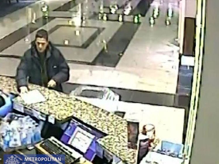 CCTV shows one suspect asking a hotel receptionist for a sheet of paper