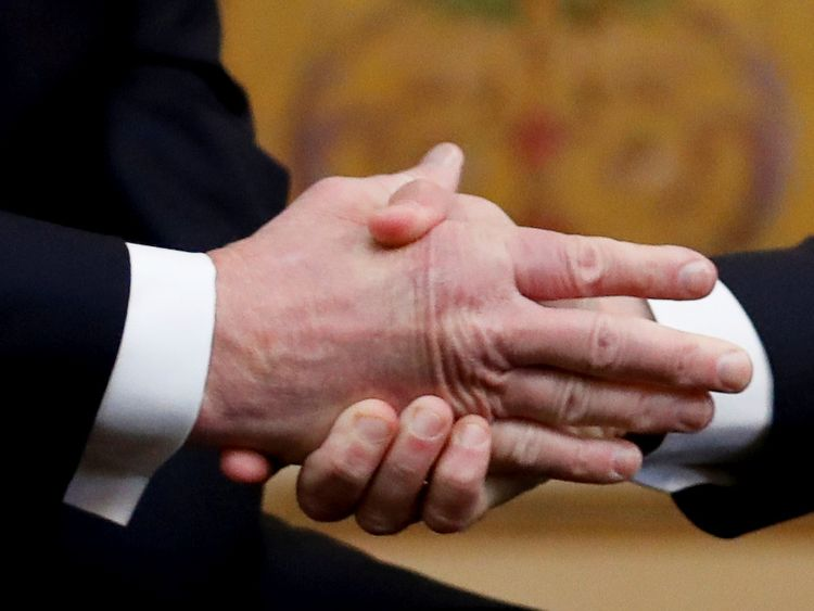 President Trump's hand is given a good squeeze by President Macron