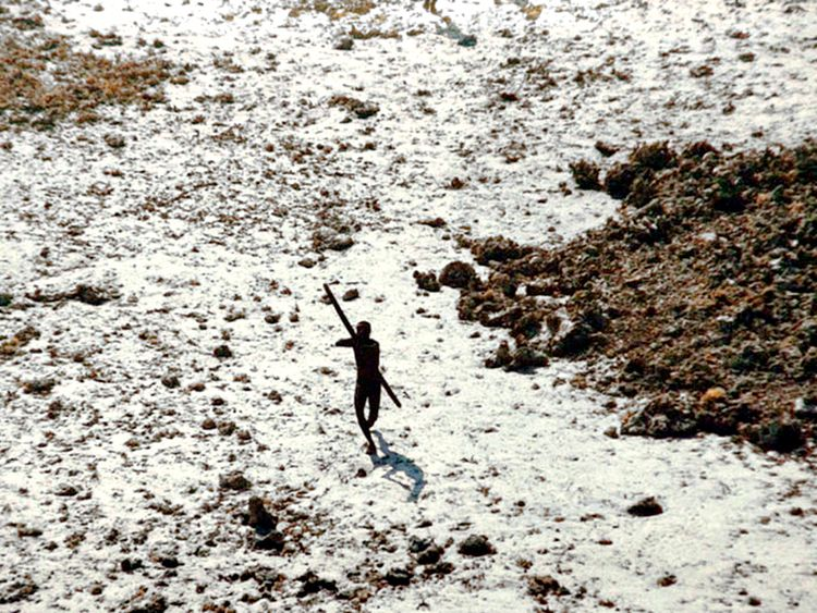 In the wake of the 2004 tsunami this member of the Sentinelese tribe was photographed firing arrows at a helicopter. Pic: © Indian Coastguard/Survival