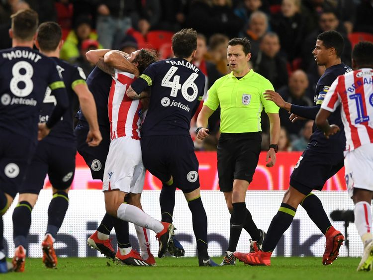 Stoke City's Joe Allen and Derby County's Bradley Johnson brawling during the match on Wednesday