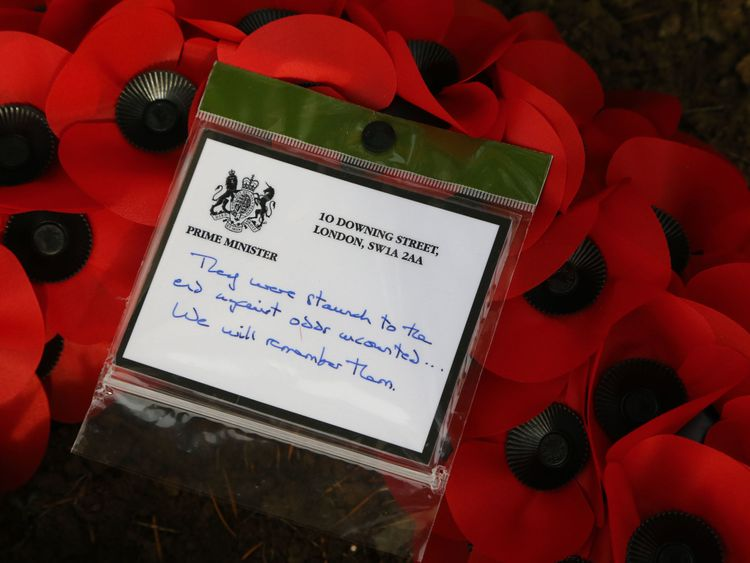 The message on a wreath that Theresa May placed at the grave of John Parr, the first British soldier to be killed in 1914, at the St Symphorien Military Cemetery in Mons