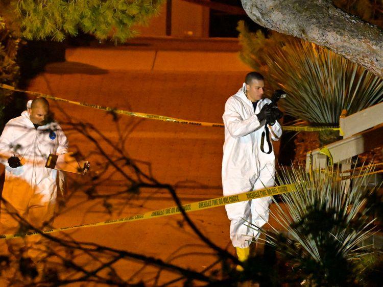 A forensics team works the scene