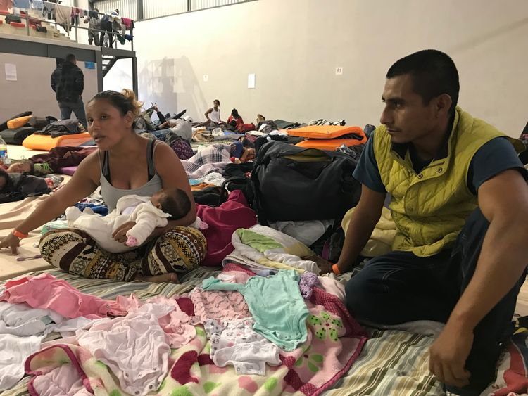 migrant camp in tiujana - Sky News pics Juan and Orlinda Arcos and their baby Juana who is 1 month and 17 days old. The baby was born during the caravan journey. Juan and Orlinda had a direct gang threat to their lives after turning in her brother who is part of a gang