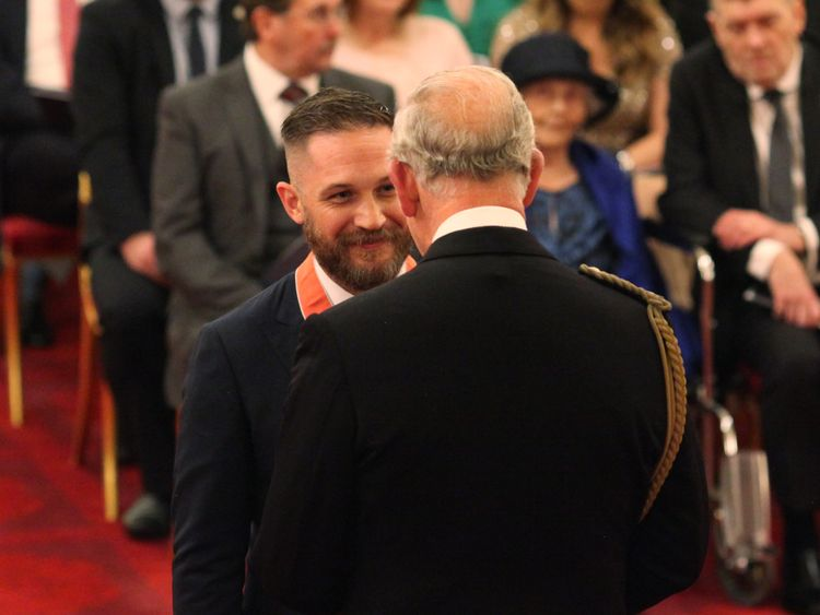 Tom Hardy laughs with Prince Charles as he is made CBE