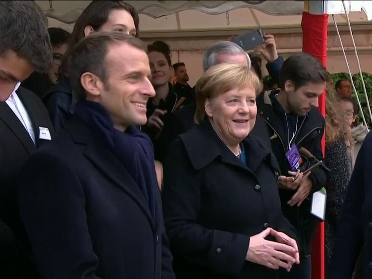 Mr Macron and Ms Merkel at a cemetery in France
