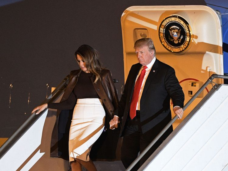Mr Trump and First Lady Melania arrive on the eve of the summit