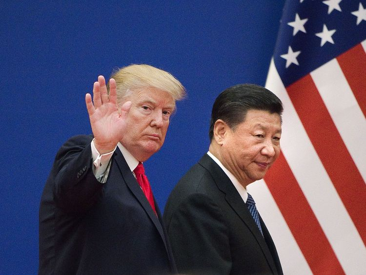 Huawei founder denies his company helps China spy, and he praises Trump