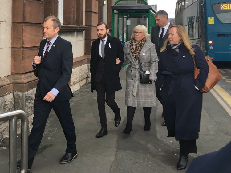 Jack Sargeant (centre) who took over from his father as an AM, enters court with his mother, Bernie Sargeant (in grey)
