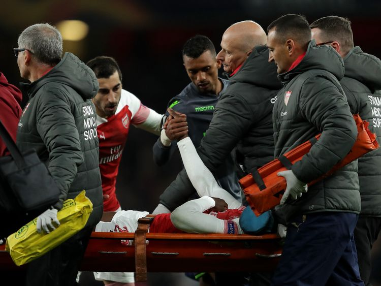 Referee Gediminas Mazeika stands over Danny Welbeck of Arsenal as he is injured during the UEFA Europa League Group E match between Arsenal and Sporting CP at Emirates Stadium on November 8, 2018 in London, United Kingdom.