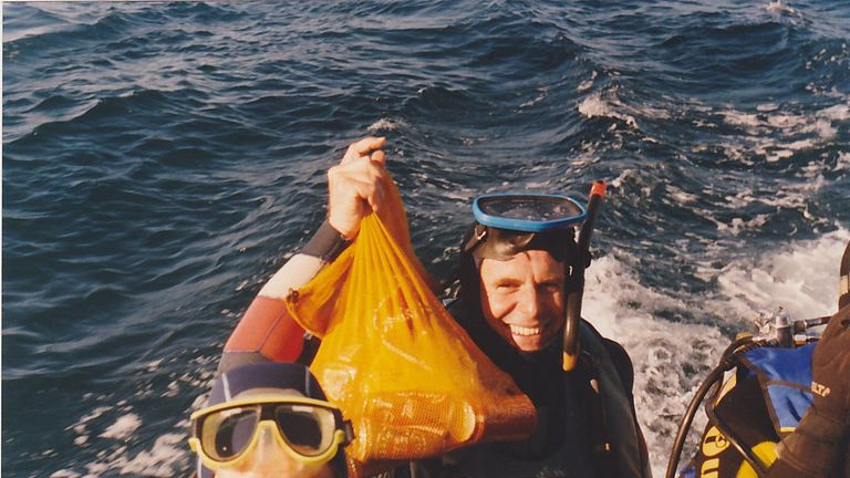 Diver Jim Anderson, who discovered a 150-year-old bottle of Tennents stout from the wreck of the clipper ship, the Light of the Age off the coast of Melbourne