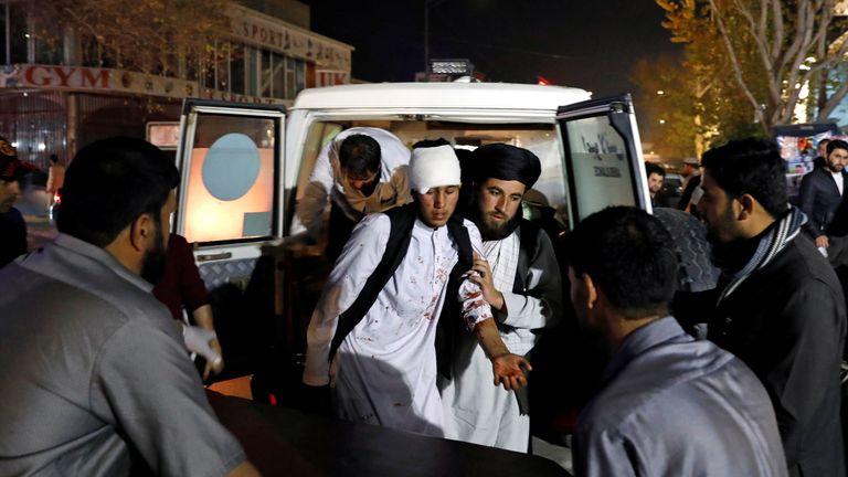 An injured man is carried into hospital after the suicide attack in Kabul