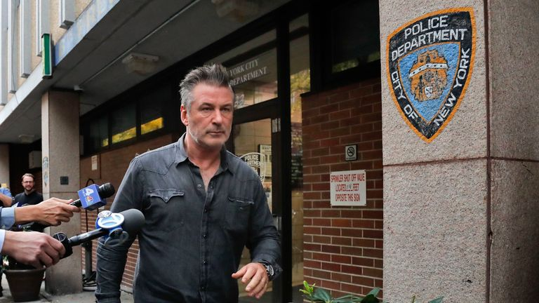 Actor Alec Baldwin walks out of the New York Police Department's 10th Precinct after he was arrested after allegedly punching a man in the face during a dispute over a parking spot outside his New York City home, authorities said.(Photo/Julie Jacobson)