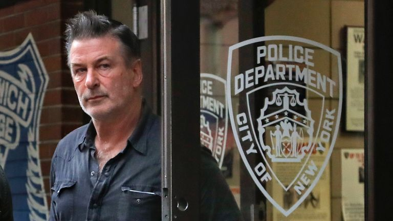 Actor Alec Baldwin walks out of the New York Police Department