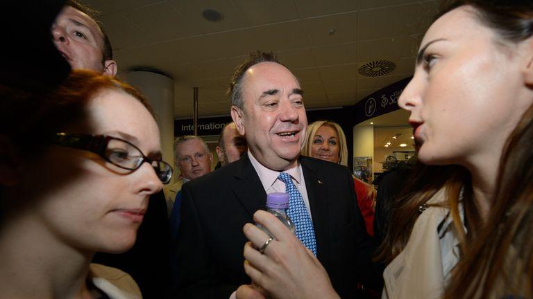 Scotland's First Minister Alex Salmond (C) hosting an event at Edinburgh airport in 2014
