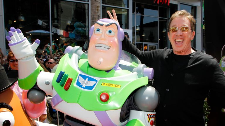 Tim Allen poses with the character Buzz Lightyear