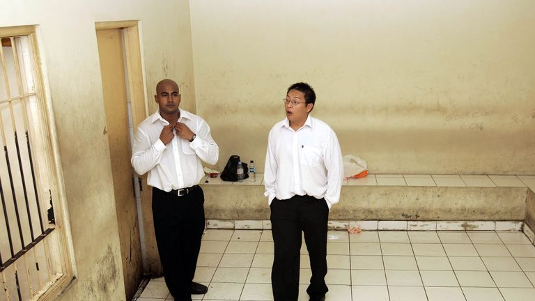 Australians Myuran Sukumaran and Andrew Chan  wait in a holding cell at a Denpasar court on the Indonesian resort island of Bali February 14, 2006. Both men were sentenced to death for drug trafficking