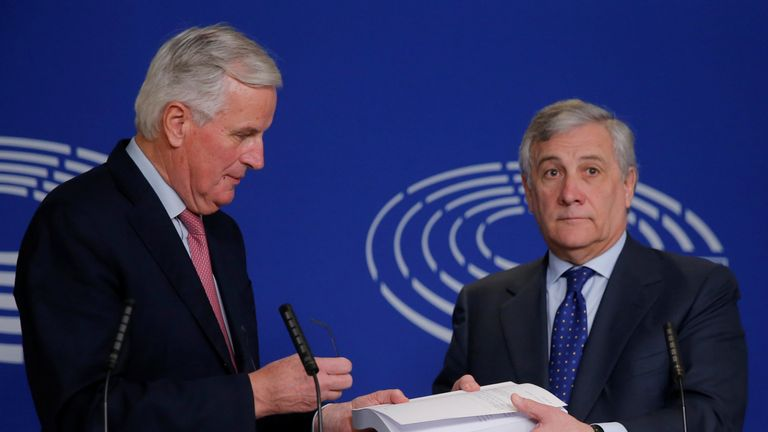 European Parliament President Antonio Tajani and European Union's chief Brexit negotiator Michel Barnier hold the agreement of the withdrawal of the UK
