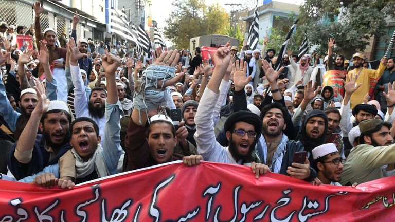 Pakistani supporters of the Jamiat Ulema-e-Islam-Fazl (JUI-F), a hardline religious political party, chant slogans