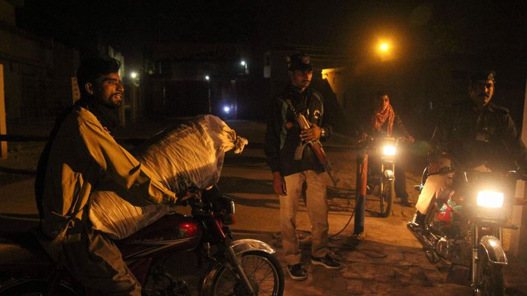 Pakistani police stand guard at the gates of the central jail where Asia Bibi was held