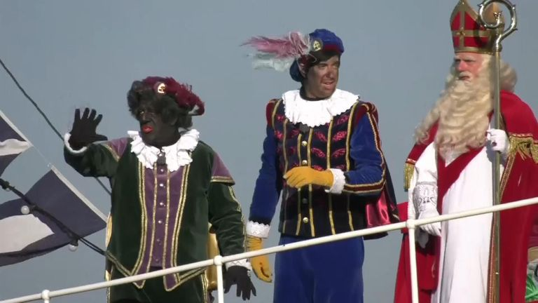 Two Black Petes dressed up with Sinterklaas