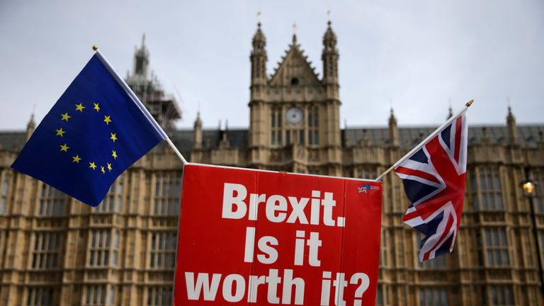 A sign that reads 'Brexit. Is it worth it?' as demonstrators protest outside the Houses of Parliament in central London on September 10, 2018