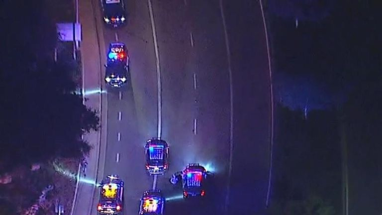 Police lock down the streets in Thousand Oaks, California, after a shooting at a bar