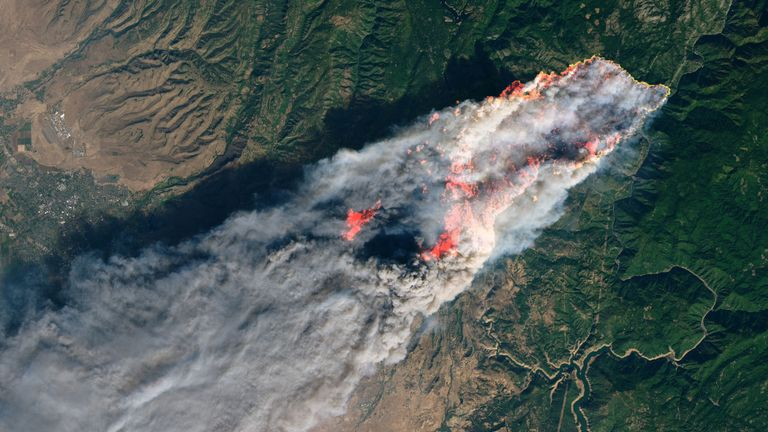 NASA's Operational Land Imager satellite image shows the Camp Fire burning at around 10:45 a.m. local time near Paradise, California, U.S., on November 8, 2018. Picture taken on November 8, 2018. Courtesy NASA/Handout via REUTERS ATTENTION EDITORS - THIS IMAGE HAS BEEN SUPPLIED BY A THIRD PARTY.