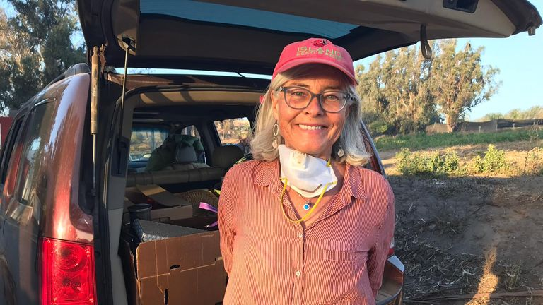 Kerry Clasby's organic farm was part destroyed in Malibu. She ignored evacuation orders and stayed to try to save her farm