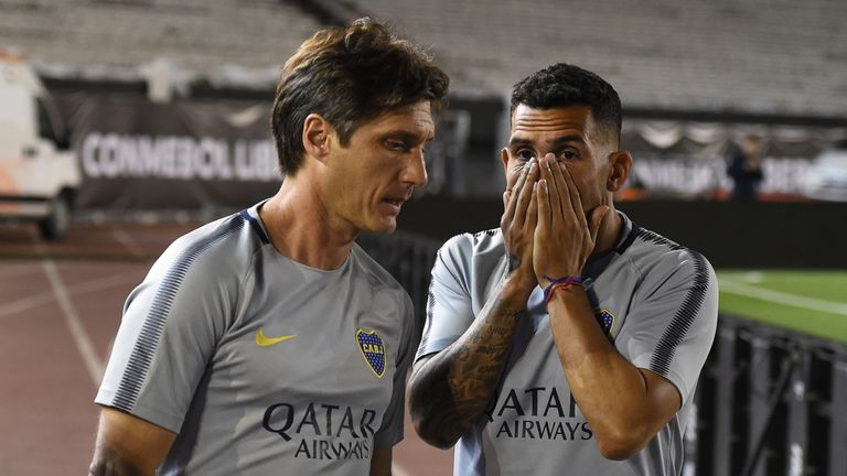 Boca coach Guillermo Barros Schelotto and striker Carlos Tevez
