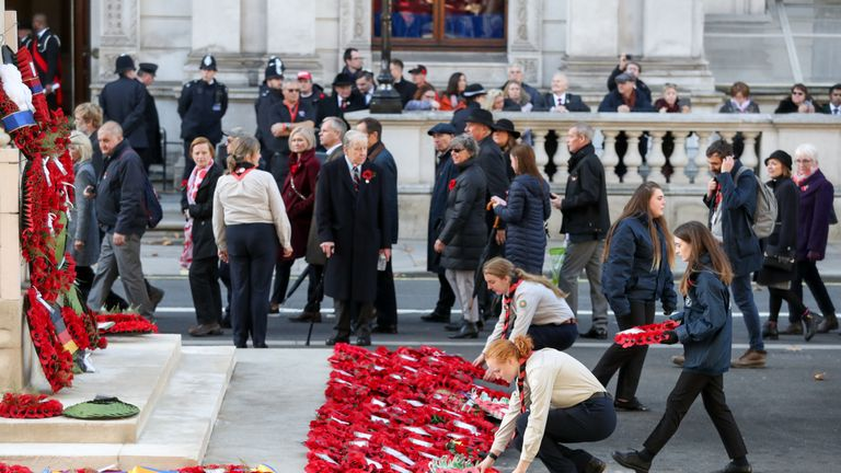 Wreaths are laid on behalf of the public as they make their way past the Cenotaph in The People's Procession