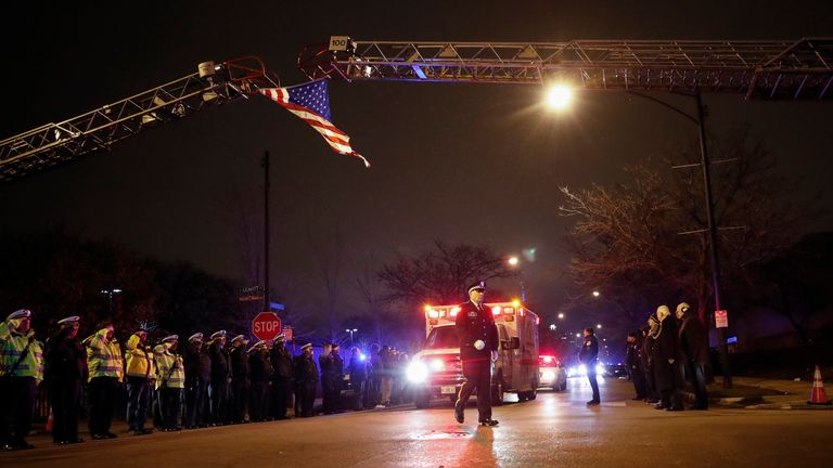 The body of slain Chicago police officer Samuel Jimenez at the shooting at the Mercy Hospital is being escorted to the Medical Examiner Office on November 19, 2018 in Chicago. - An argument in a hospital parking lot escalated into a shooting that killed three people, including a police officer, in the US city of Chicago on November 19, 2018. The violence only ended when police engaged in shootout with the gunman inside Mercy Hospital. 'We have four deceased individuals: police officer, two femal