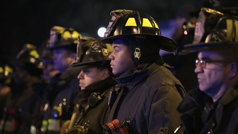 Chicago firefighters and police officers line up outside of the Cook County Medical Examiner's office waiting for the remains of Chicago Police officer Samuel Jimenez on November 19, 2018 in Chicago, Illinois. Jimenez was killed today responding to a shooting at Mercy Hospital which also claimed the lives two hospital workers and the gunman. (Photo by Scott Olson/Getty Images)