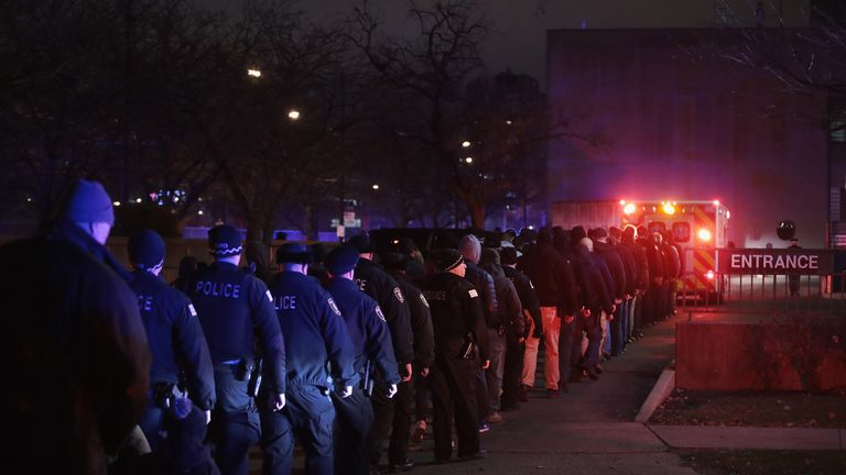 Police and firefighters follow the ambulance carrying the remains of Chicago Police officer Samuel Jimenez as it arrives at the Cook County Medical Examiner's office on November 19, 2018 in Chicago, Illinois. Jimenez was killed today responding to a shooting at Mercy Hospital which also claimed the lives two hospital workers and the gunman. (Photo by Scott Olson/Getty Images)