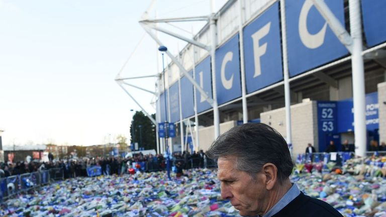 The  French manager Claude Puel looks at the floral tributes left to the victims