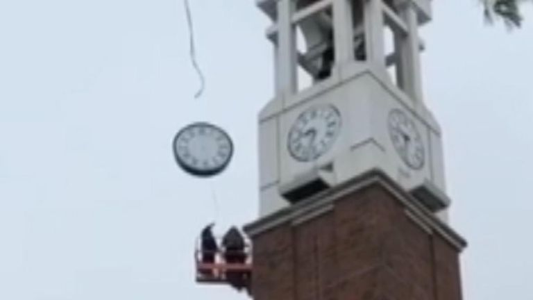 Repair crew in cherry picker narrowly miss falling clock face