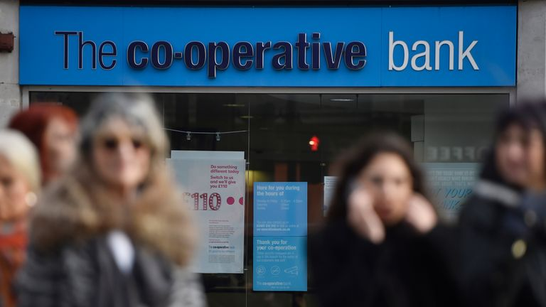 People walk past a branch of The Co-operative Bank in London