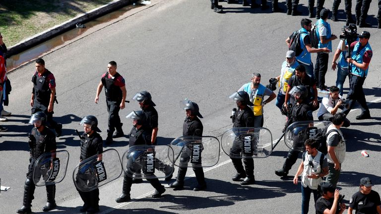 Riot police outside the Estadio Monumental in Buenos Aires