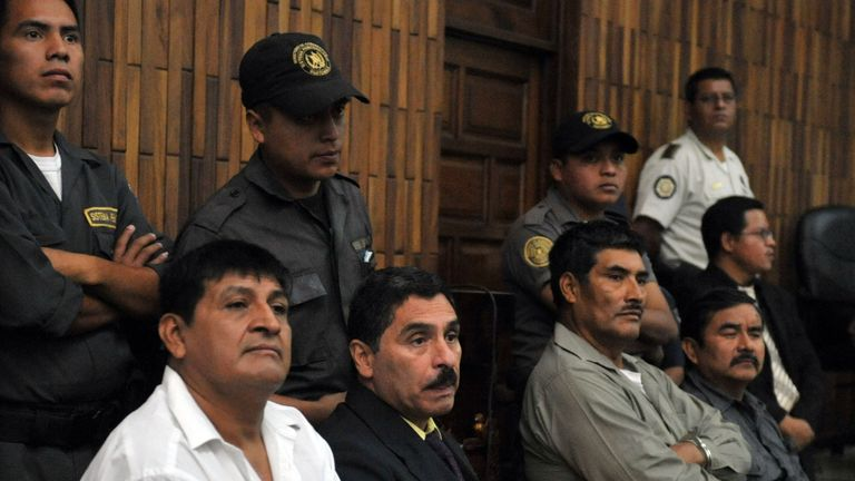 Daniel Martinez, Carlos Carias, Manuel Pop and Reyes Collin, four military men accused of an extra-judicial execution of 252 farmers in 1982, await in court during their trial, in Guatemala City, on July 26, 2011. The killing was one of the bloodiest slaughters during the 1960-96 civil war in Dos Erres village