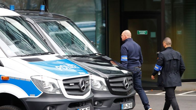 Police walks in front of Deutsche Bank headquarters as roughly 170 criminal police officers, prosecutors and tax inspectors searched Deutsche Bank offices in and around Frankfurt, Germany, November 29, 2018, on money laundering allegations, the public prosecutor said in a statement.