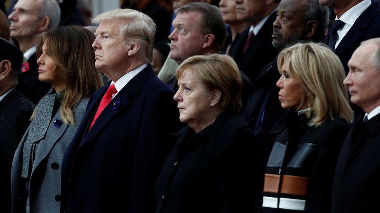 Donald Trump, Angela Merkel and Vladimir Putin at the ceremony in Paris