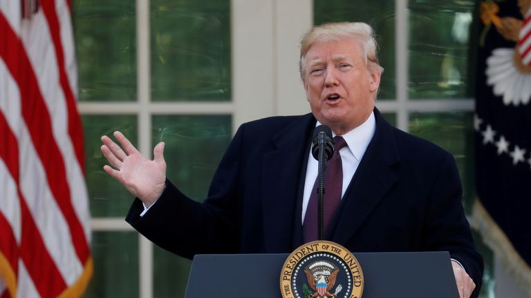 Mr Trump says troops will intervene if control is lost at the border