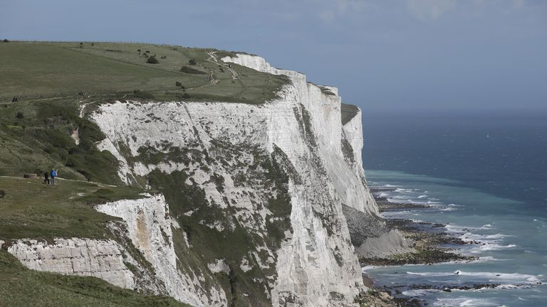 A couple stand on the top of the White Cliffs of Dover on April 26, 2018
