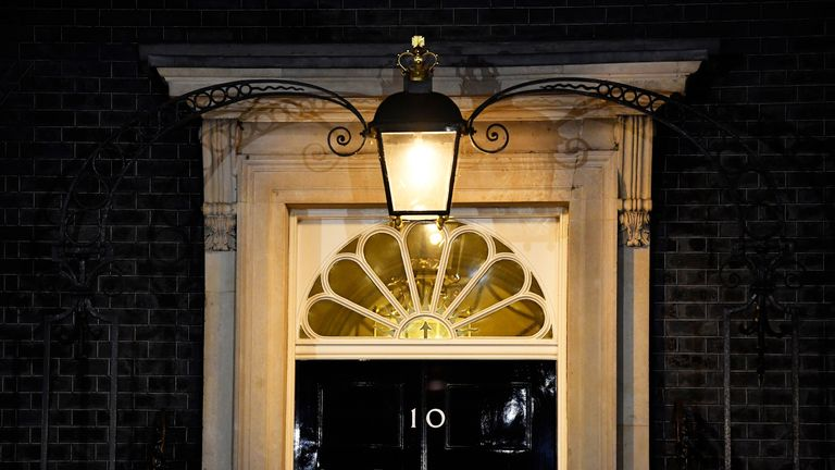 The light shines above the door of 10 Downing Street as the cabinet sits
