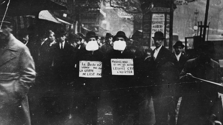 Men wearing flu masks in Paris during the Spanish flu epidemic which followed World War One