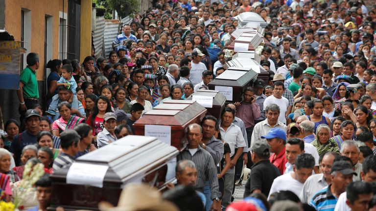 A funeral procession of victims who died in Fuego's July eruption