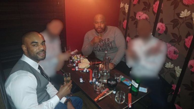 Nyron Hughes (left) and Ramone Carty drinking out of champagne flutes ahead of their convictions. Pic: City of London Police