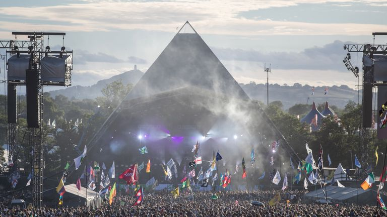 People gather in front of the Pyramid Stage  at Worthy Farm, Glastonbury Festival, 2017