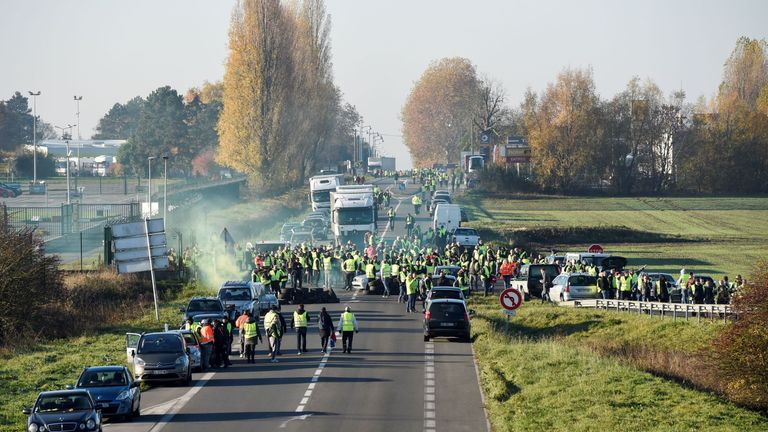 Demonstrators wearing yellow vests (Gilets jaunes) block the traffic during a protest against the rising of the fuel and oil prices on November 17, 2018 on the A2 road in Haulchien near Valenciennes, northern France