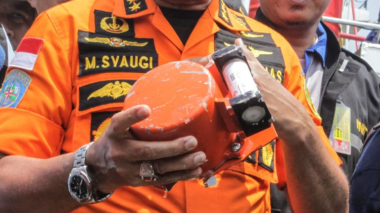 Chief of National Search and Rescue Agency Muhammad Syaugi shows a part of the black box of Lion Air's flight JT610 airplane